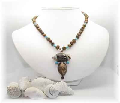 A stunning necklace featuring beautiful shells, turquoise and pearls~
