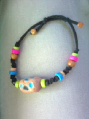 A fun and bright clay and bead bracelet.